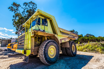 Large green dumper truck on construction site