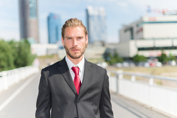 Handsome businessman in a business environment