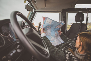 Woman looking at the map during the journey