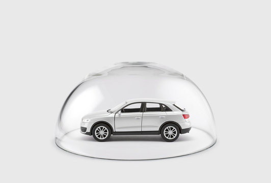 Modern silver car protected under a glass dome