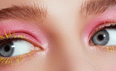 Creative beauty Makeup. Natural long green eyelashes closeup. Beauty model woman face makeup with fantasy bright eyelash. Model face