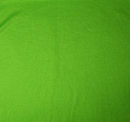green stretching soft fabric, full frame