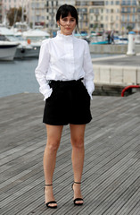 "Phoebe Fox poses during a photocall for the television series ""Curfew"" during the annual MIPCOM television programme market in Cannes"