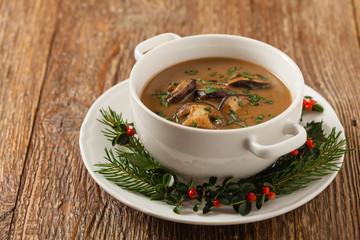 Traditional mushroom soup, made from porcini mushrooms. Christmas decoration.