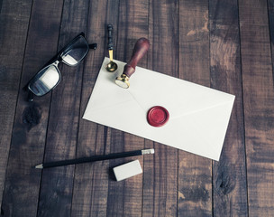 Vintage envelope and postal stationery on wooden background. Flat lay.