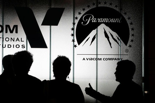 Visitors are silhouetted at the Paramount Pictures stand during the annual MIPCOM television programme market in Cannes