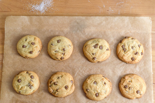 Fresh homemade chocolate chip cookies on baking paper