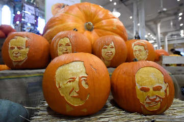 Halloween pumpkins including President Michael D. Higgins are seen in a shop with Ireland's Presidential candidates faces carved into them ahead of an upcoming Presidential election in Dublin