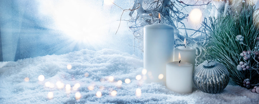 Winter decoration in snow with golden bokeh