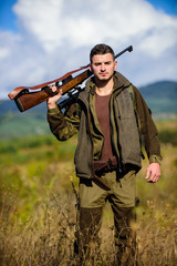 Hunting season. Hunting weapon gun or rifle. Man hunter carry rifle nature background. Experience and practice lends success hunting. Guy hunting nature environment. Masculine hobby activity
