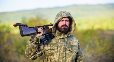 Foto op Plexiglas Jacht Bearded hunter rifle nature background. Hunting big game typically requires tag each animal harvested. Experience and practice lends success hunting. Hunting season. Guy hunting nature environment