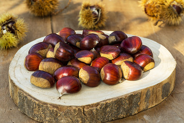 Fresh sweet chestnut. Chestnuts on rustic and wooden table.