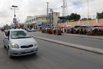 Car passes along KM4 street near scene of last year's October attack in Mogadishu
