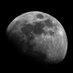 Big Moon, in waxing gibbous phase, taken with telescope, isolated in dark background (square version).