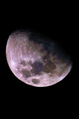 Big Mineral Moon, in waxing gibbous phase and with its natural colors, taken with telescope, isolated in dark background.