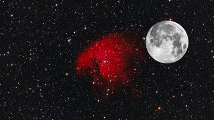 Big Moon and Pacman Nebula as background with many stars around, all object of this composition are taken with telescope.