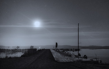 Boat harbour on moonlight (black & white)