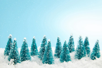 Сoniferous forest. Christmas trees and snowfall. Christmas and new year background.