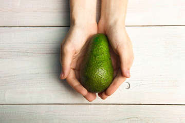 Ripe avocado in hand