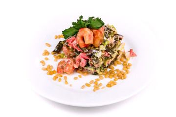 Salad of shrimps, green beans, cabbage and pine nuts