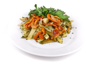 Salad of fried potatoes, mushrooms and gherkins