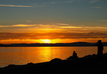 Couple. Sunset. Lake. Color. Silhouette