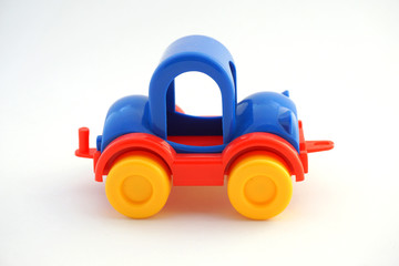 Children's toy - a car. Little bright machine. Isolated on white background.