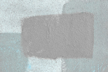 grey square is drawn with paint on the cement wall.abstract background