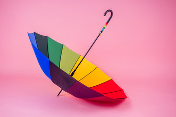 colorful rainbow umbrella on a pink background in the studio