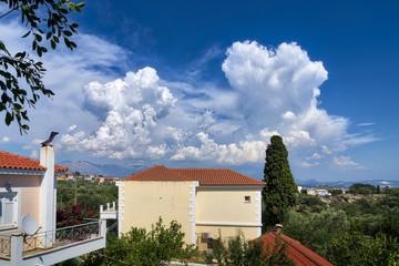 Mediterranean house and landscape with dramatic cloudscape