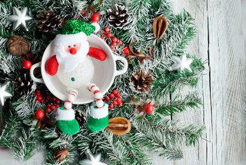 Christmas wreath and snowman, greeting card and Christmas background on light background.