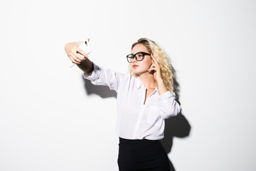 Closeup of beautiful playful business woman making selfie on isolated white background