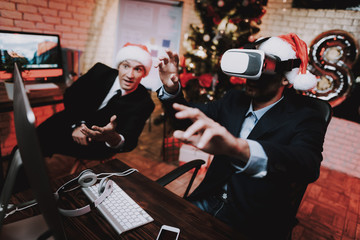 Businessmen Playing on Computer with VR-glasses.
