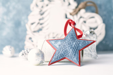 Vintage Christmas ornaments. Christmas star.  Symbolic image. Christmas background. White - blue background. Close up. Copy space.