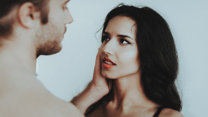 Beautiful Sexy Woman Looks into Eyes Man in Room.