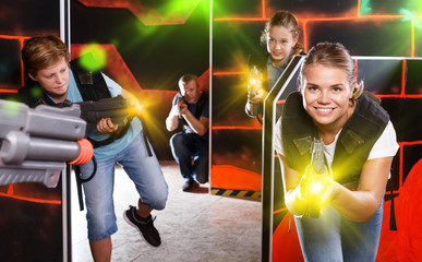 Woman playing lasertag with family