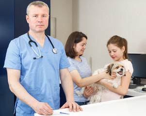 Confident male veterinarian in vet office