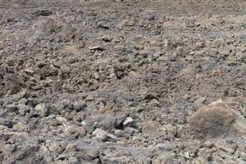 The soil on the slopes of the volcano Etna in Sicily