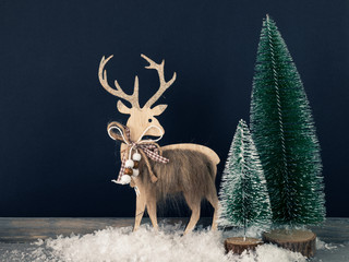 Christmas decoration wooden reindeer with fir trees