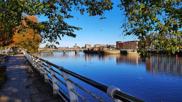limerick city skyline ireland. beautiful limerick urban cityscape over the river shannon on a sunny day with blue skies.