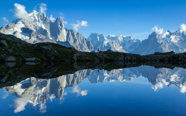 Poster de jardin Reflexion Hiker at his tent in the Mont Blanc massif reflected in Lac de Chesery. Chamonix, France.