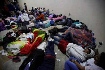Hondurans fleeing from poverty and violence rest in Ocotepeque