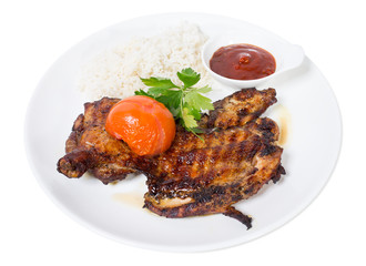 Grilled chicken tabaka with rice.