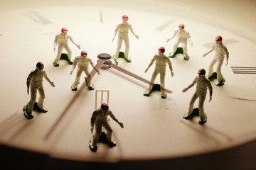 Photo Composite of Cricket Players and Clock