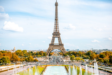 View on the Eiffel tower with fountains during the daylight in Paris