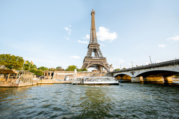 View from the boat on the Eiffel tower on Seine river during the sunset in Paris