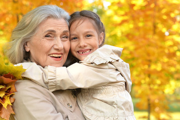 Portrait of a happy grandmother and granddaughter