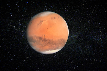 Planet Mars against the stars of the Milky Way. Elements of this image furnished by NASA