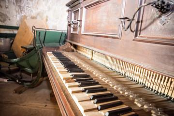 Old wooden broken piano. Abstract inside retro photo