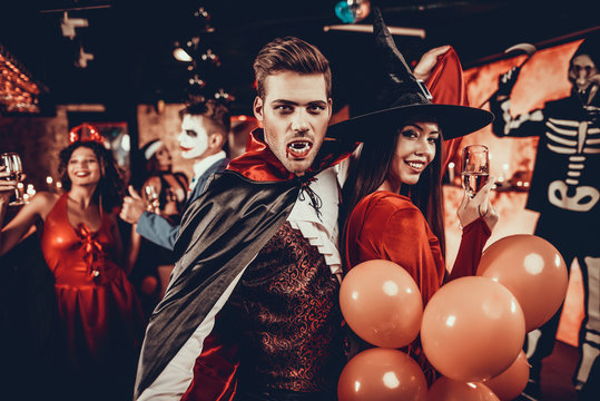 Young Happy Couple in Costumes at Halloween Party